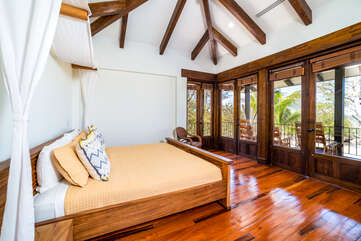 Master bedroom with king bed and an incredible view