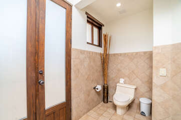 Toilet in the master bathroom
