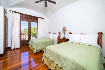 Two queen beds in the upstairs guest room