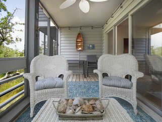Seating and dinning areas on screen porch off family room
