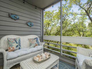 Screened porch off family room with beautiful marsh views