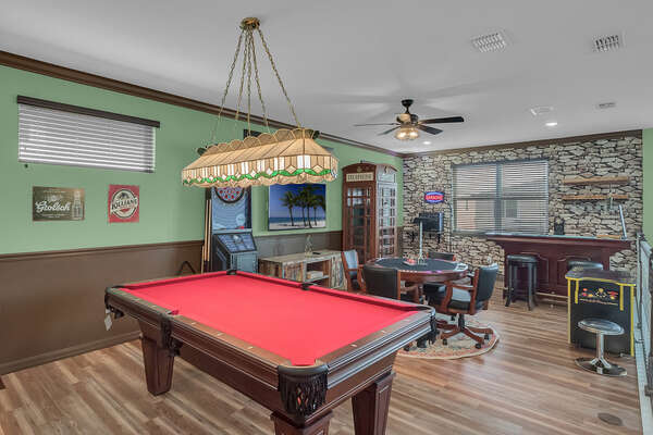 Packed with fun, the loft bar offers so much more than a standard vacation home.  Enjoy playing pool, poker, darts and multi-game arcade.  Sing your hearts out with your very own karaoke station with bar and wine fridge.