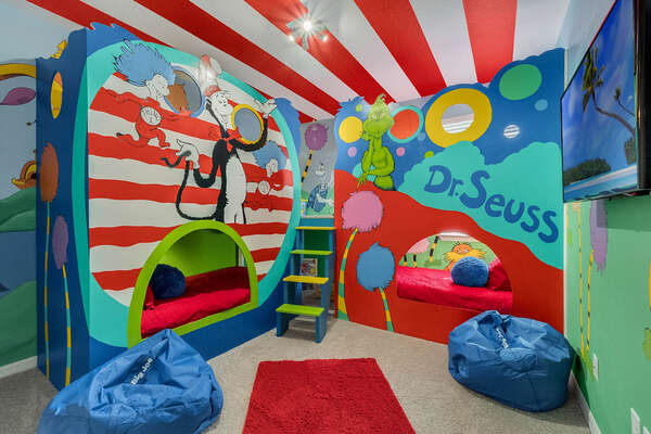 Themed bedroom with custom designed bunk beds which sleep 4 and secret play area under the stairs.  This room is located upstairs