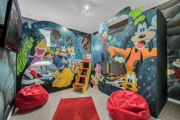 Themed bedroom with custom bunk beds that sleep up to 4 with a secret play area under the stairs.  This room is located upstairs.