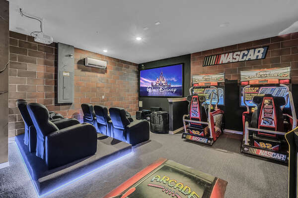 Feel like you are at the theater in your custom air conditioned movie room complete with 2 driving arcade games and a stand up multi game arcade.  Stadium seating for 6 with bean bag chairs for extra seating.  LED lighting activates with motion.