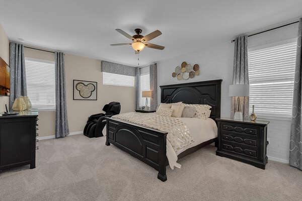 Upstairs Master suite featuring king bed, wall mounted flat panel TV.  A full body massage chair provides additional relaxation after a long day at the parks.