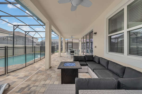 pool deck with outdoor dining and seating with firepit accent table
