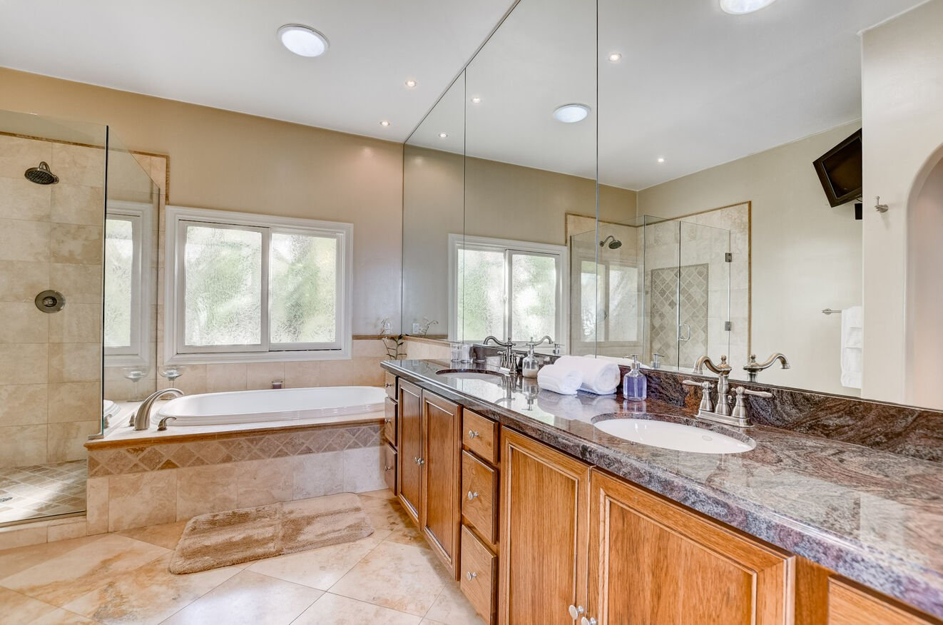 The master bath includes a separate shower and jetted tub