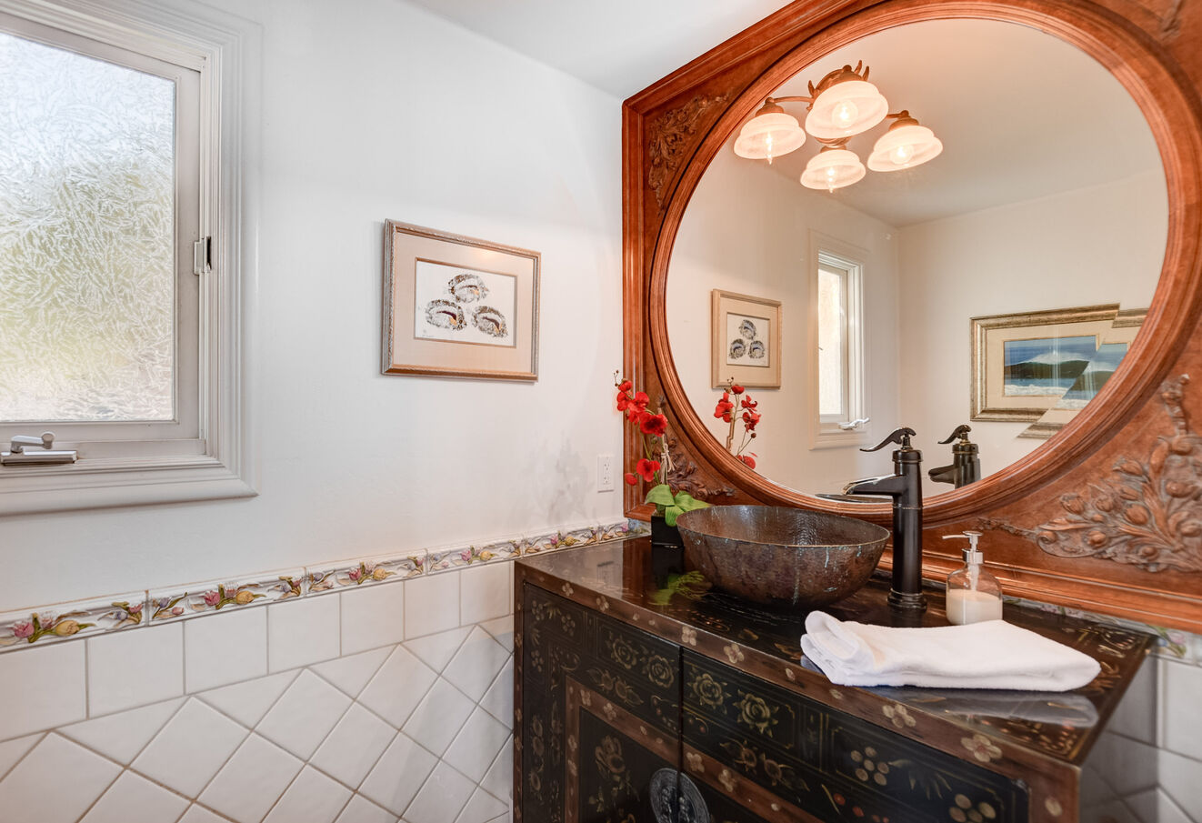 The first floor half bath features a beautiful vanity and sink
