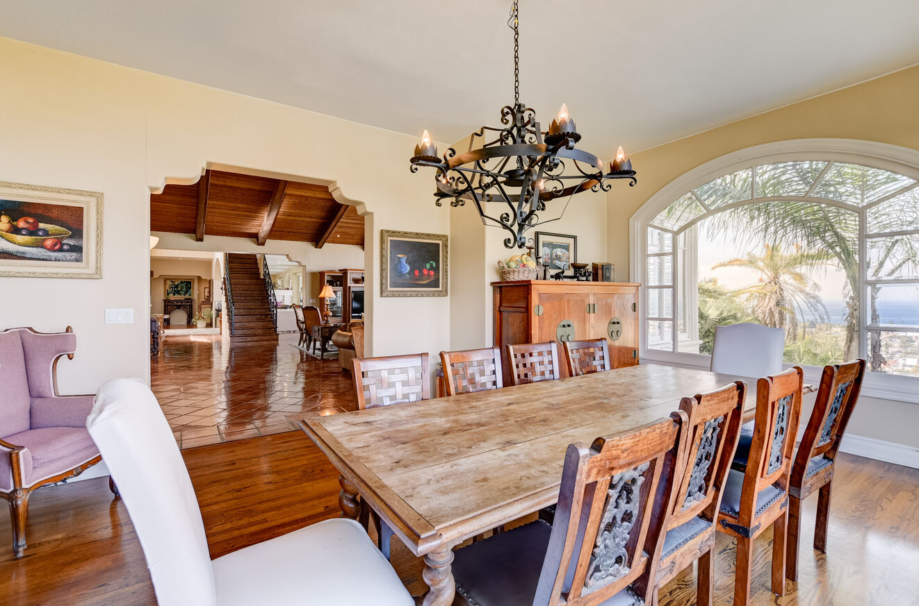 The open formal dining room offers seating for ten