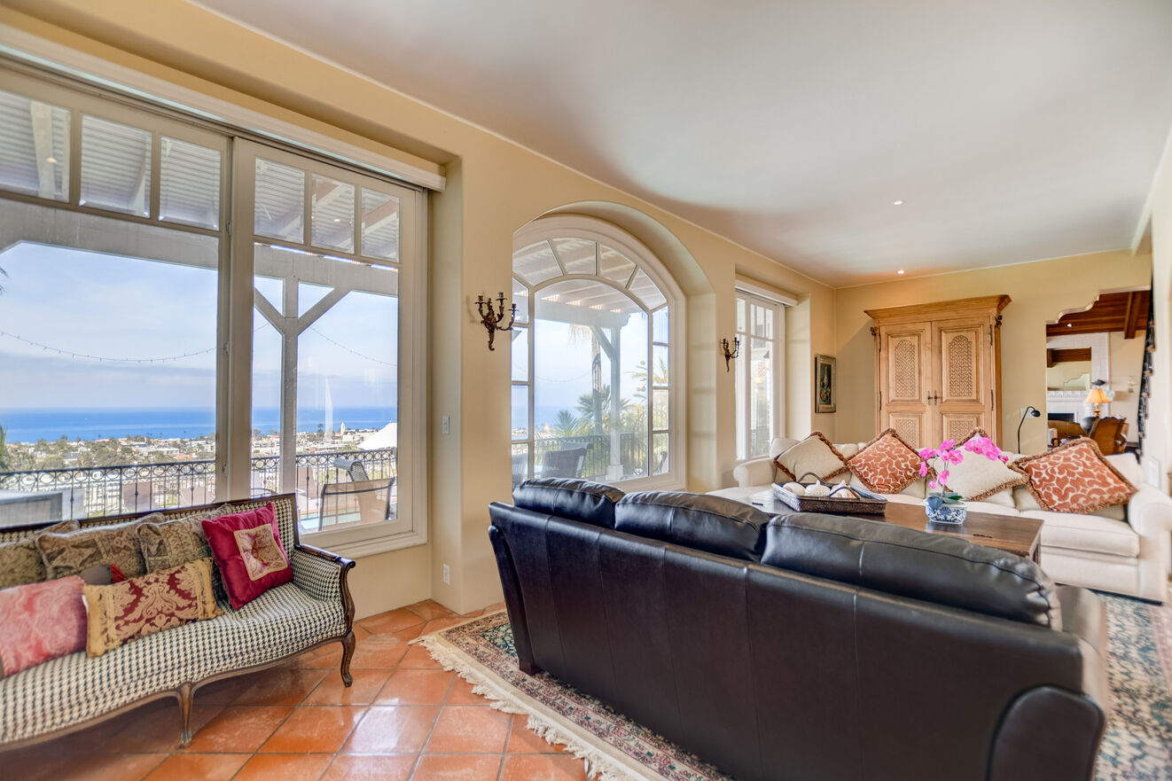 Like most rooms in the home, the formal living room offers ocean views