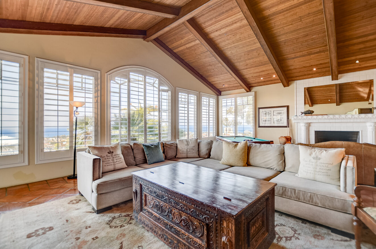 The Family Room features a pool table, fireplace, and room for everyone