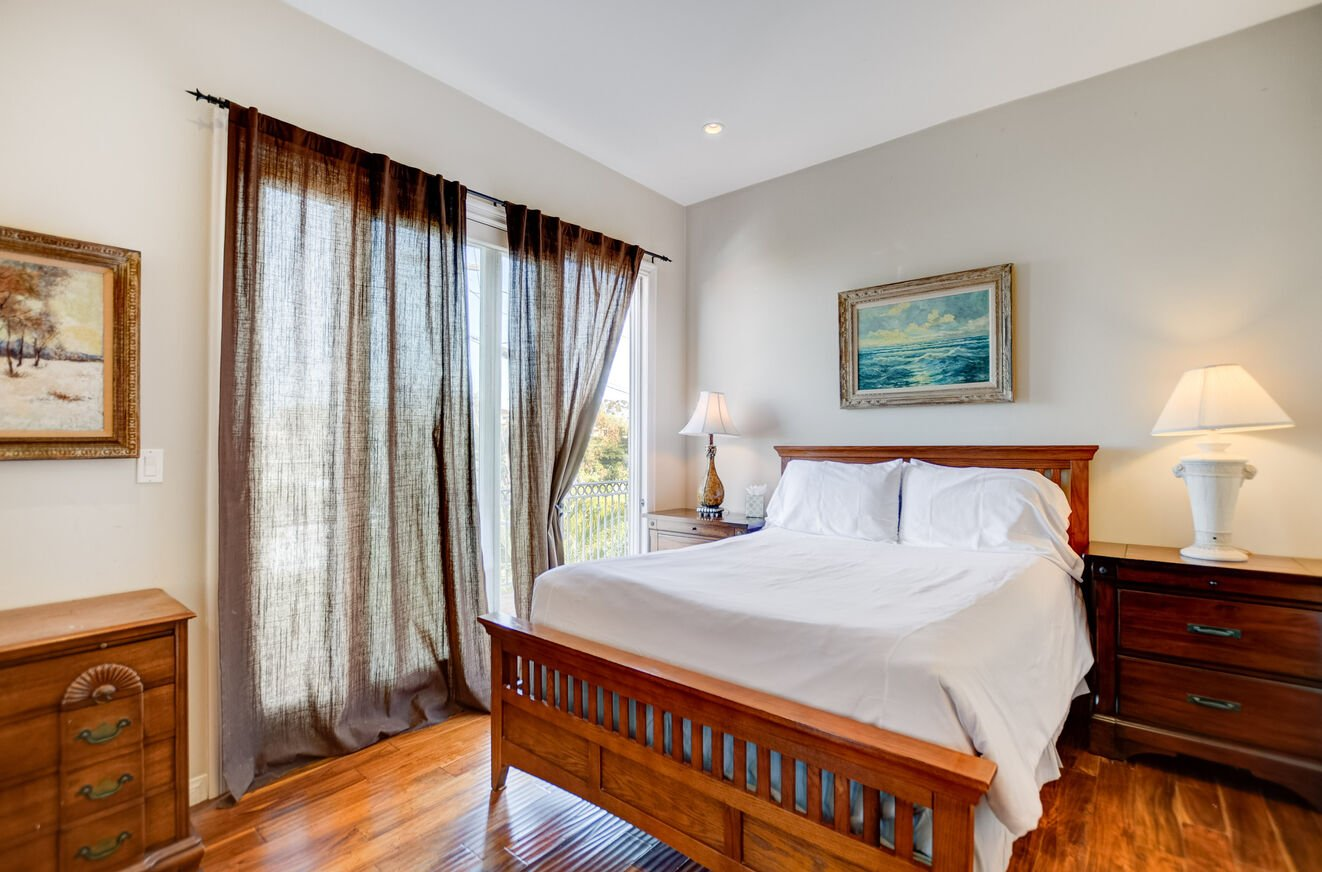 The suite has a luxurious Queen bed and shares a bathroom