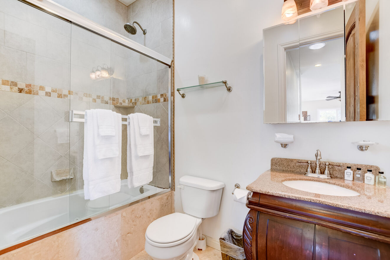 The upstairs suite shares a bathroom with shower/tub combo
