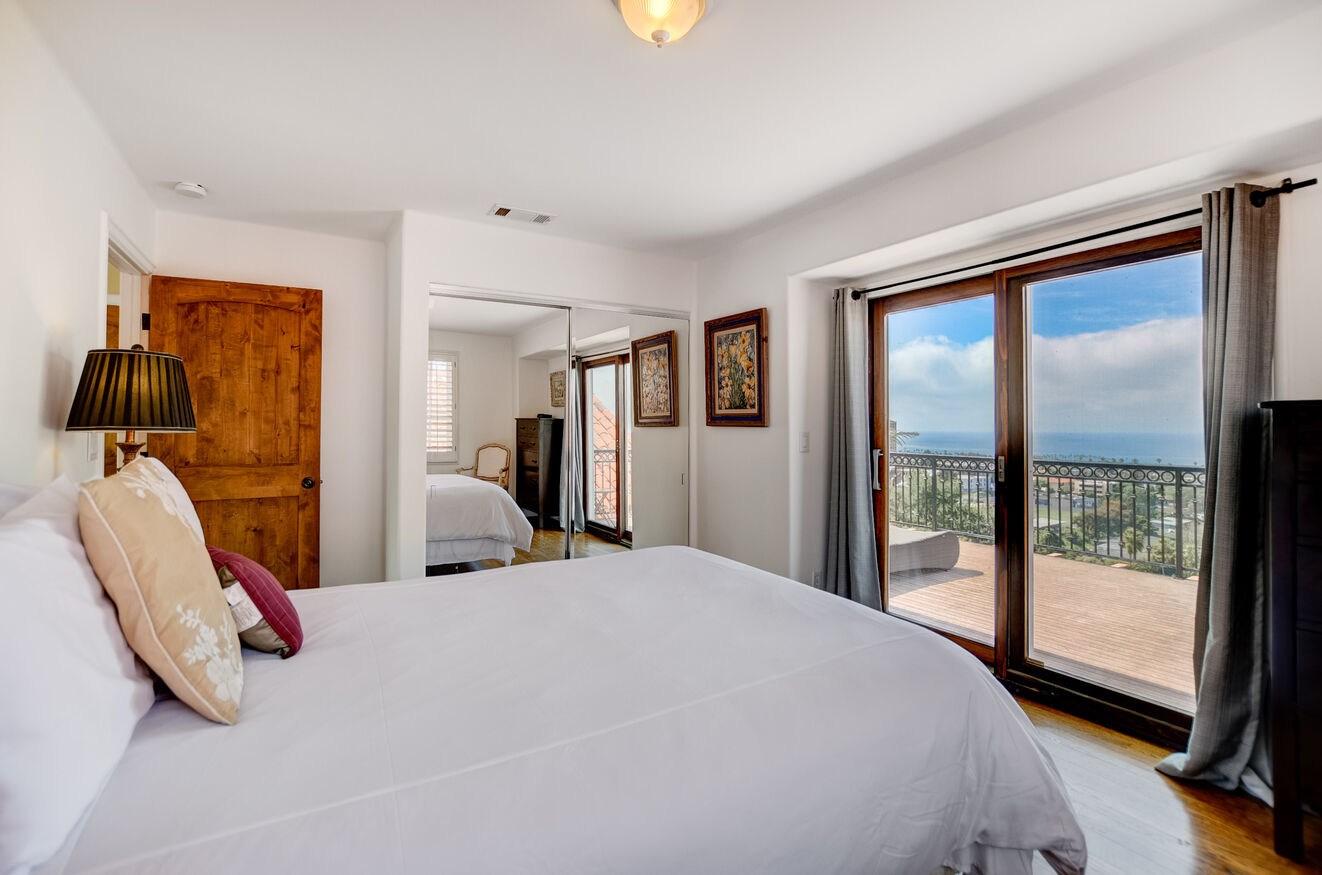 The upstairs South Wing bedroom has a Queen size bed and ensuite bathroom, along with amazing ocean views