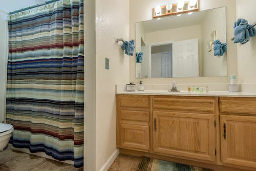 Private Entrance to Full Shared Bath with a Tub/Shower Combo