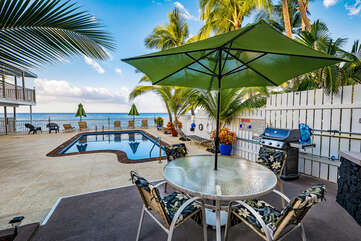 Patio table, chairs, bbq grill in the pool area