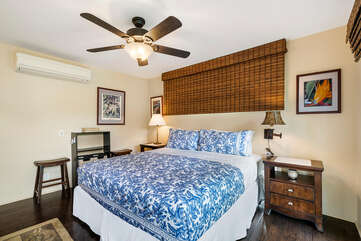 Bedroom with AC, large bed, and ceiling fan