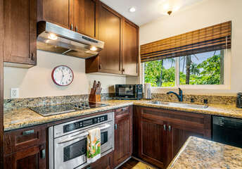 Kitchen counter with sink, microwave, and dishwasher