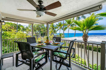 Table, chairs and ceiling fan on the oceanfront lanai