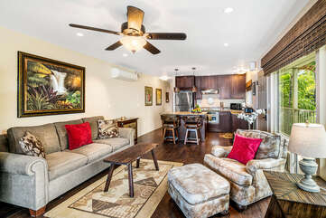 Sofa, armchair, ceiling fan, kitchen island with seating for two