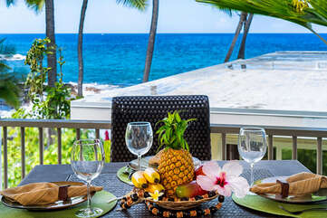 Table and chair in the lanai of our ocean front condo Kauai