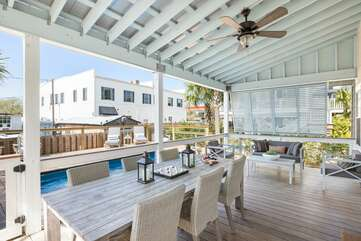 Expansive porch space with plenty of seating for you entire family