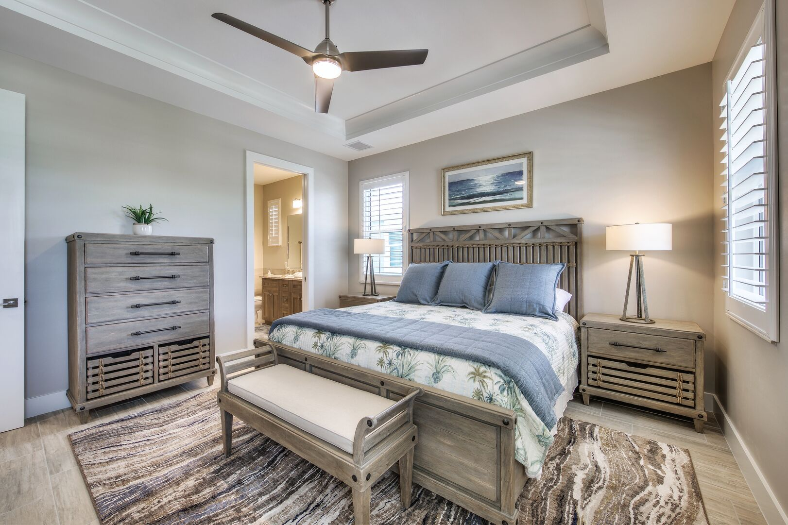 Bedroom with Dressers and Large Bed