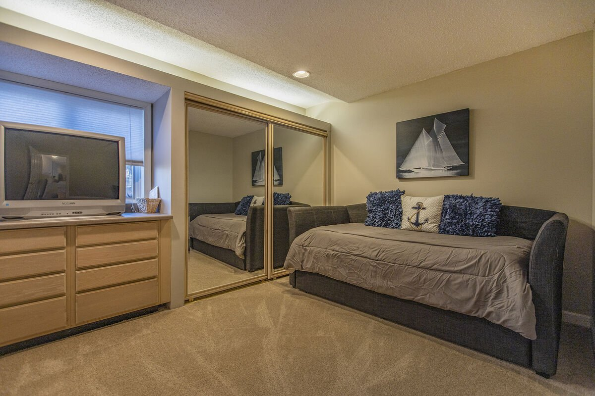 Lower Level trundle Bedroom with TV