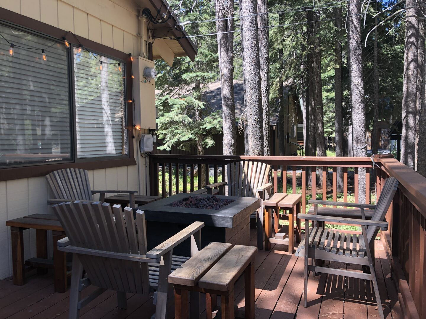 Outdoor Fire Pit and Wooden Chairs on the Deck
