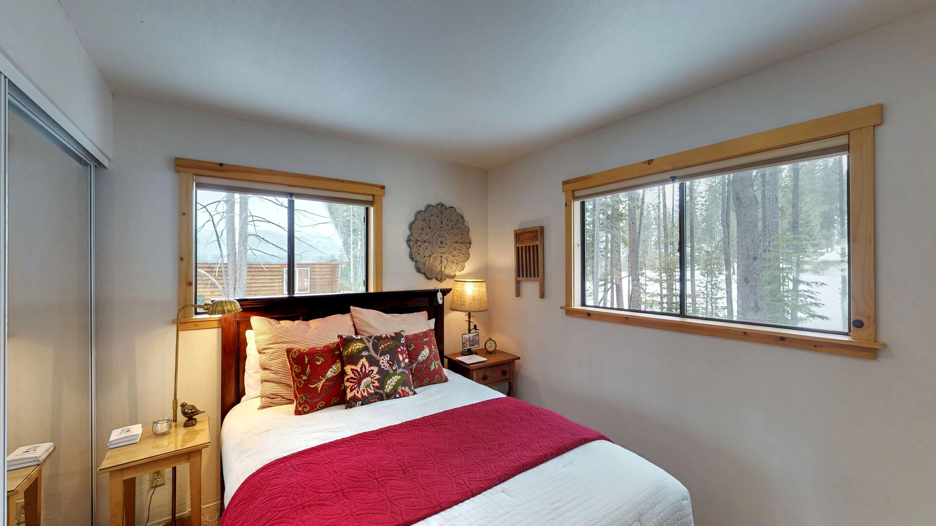 Corner Bedroom with Two Large Windows in Camp Howdy