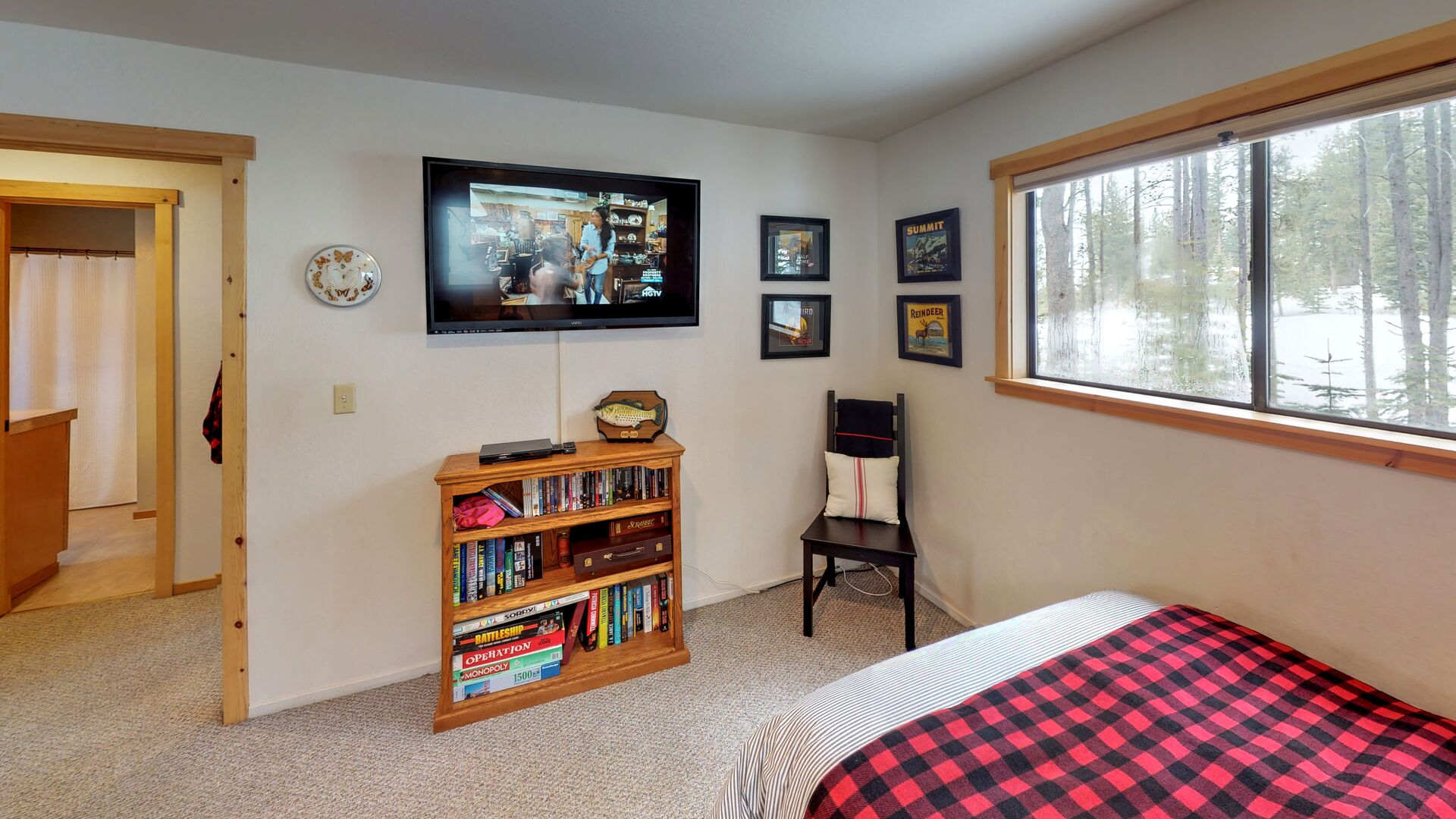 Mounted TV Above a Bookshelf in the Second Bedroom