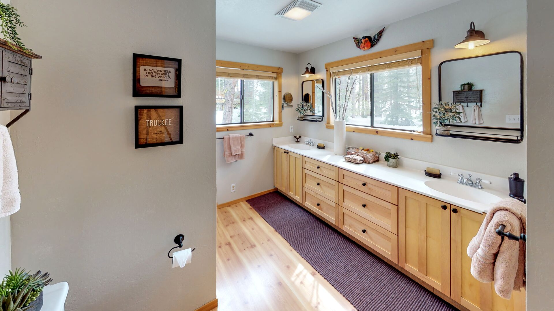 Spacious Bathroom with Dual Sinks in Camp Howdy