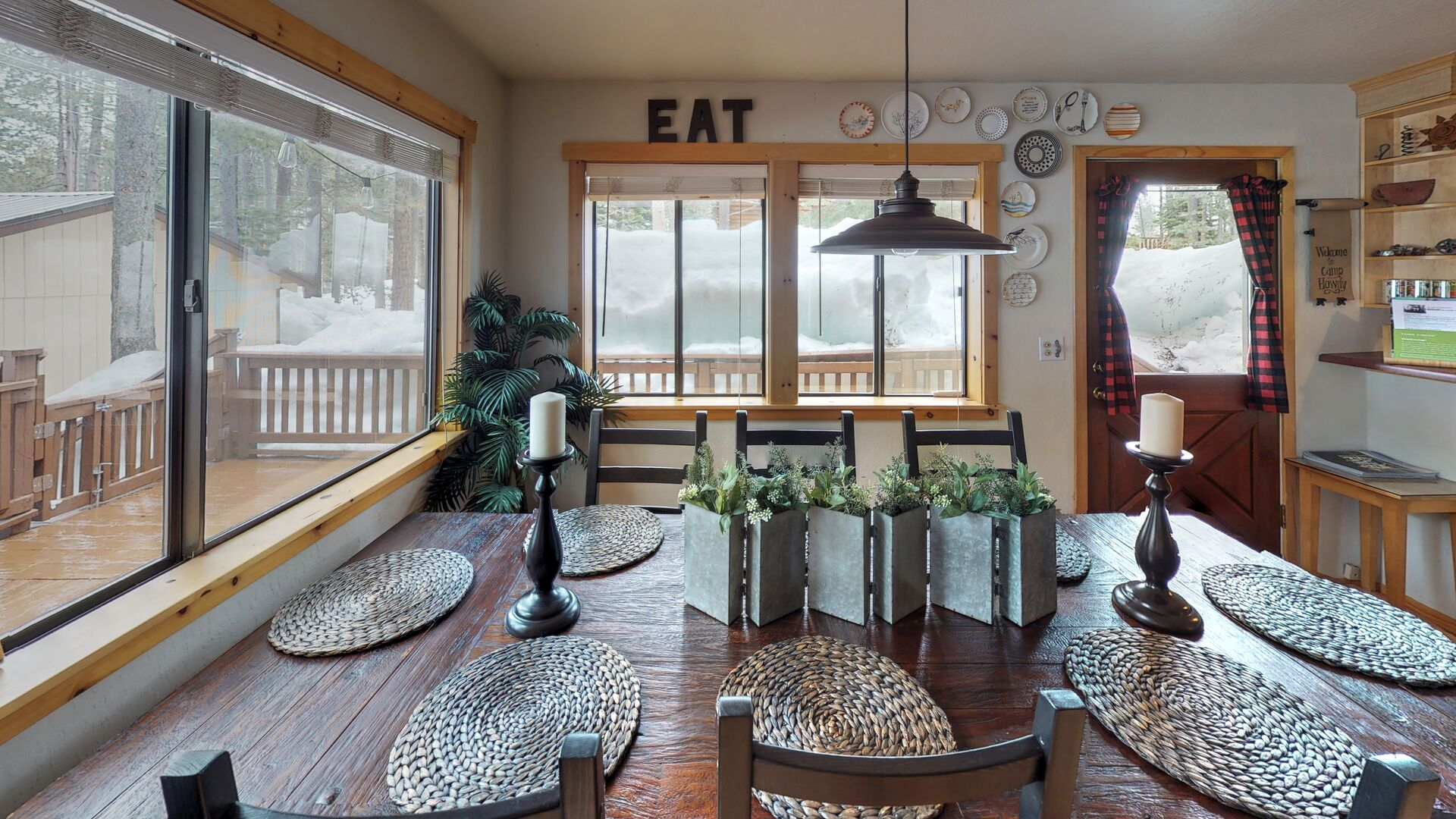 Dining Table with Place Settings in Camp Howdy Property