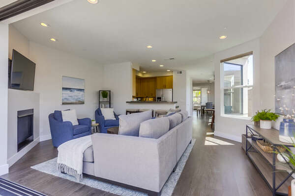 Living Area Includes Two Blue Accent Chairs.