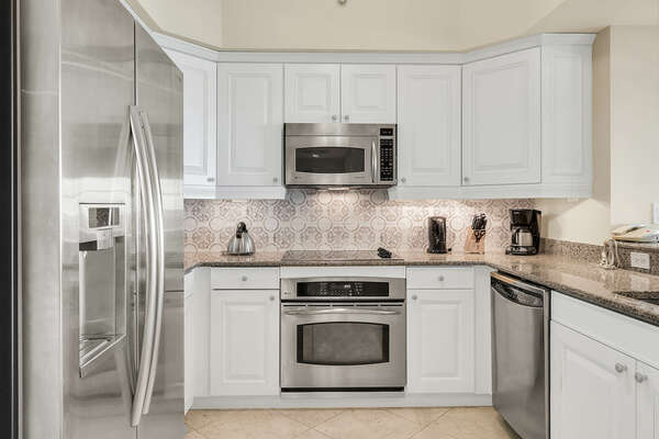 Fully equipped modern kitchen with stainless-steel appliances