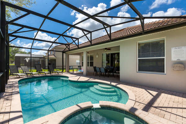 Enjoy the Florida sunshine at your own private screened-in pool