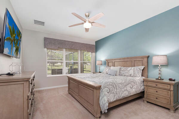 The first floor master suite features a King bed and views of the private pool