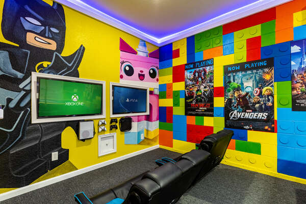 The gaming setup features two 43-inch TVs connected to an Xbox One and Playstation 4
