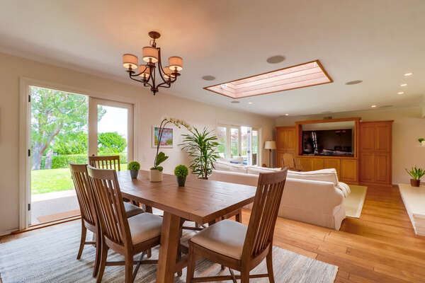 Dining Room with seating for 4, and view into the living area.