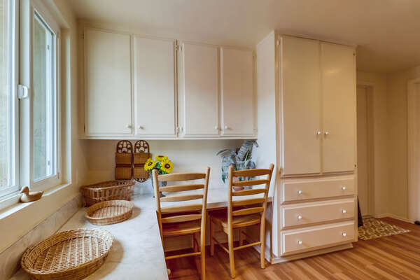 Mud Room with seating for two, and ample cabinetry.
