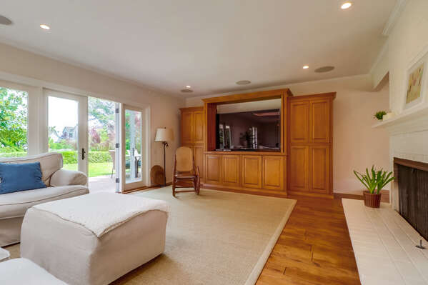 Family Room with TV in a large entertainment center.