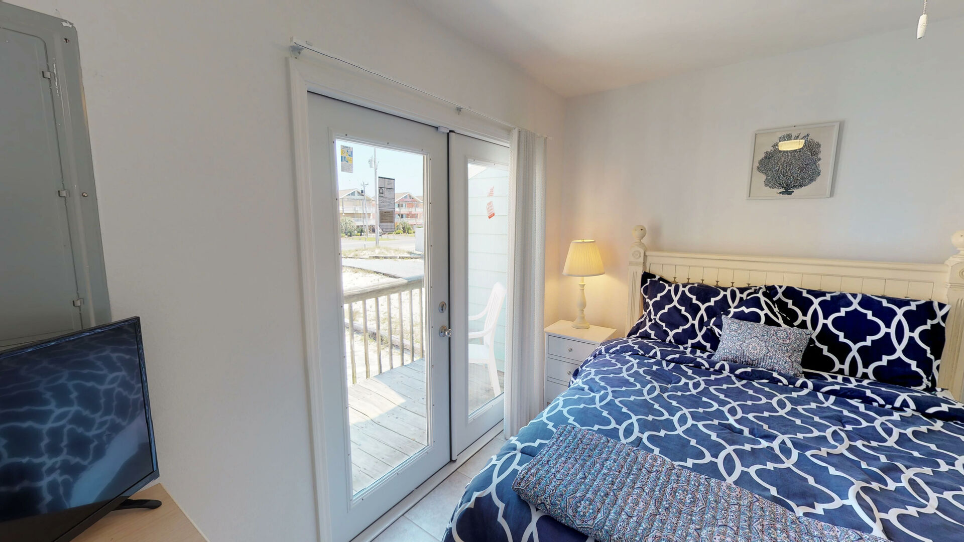 First Floor Bedroom with Queen Bed and Balcony access