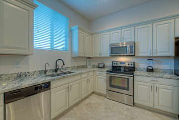 Casita's kitchen is complete with full size appliances and all the desired kitchen gadgets