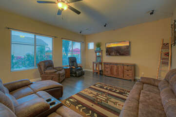Great room offers comfortable and reclined seating to view TV or picturesque outdoors