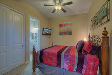 The seventh bedroom has a queen bed and TV and shares the third bathroom with any additional house guests