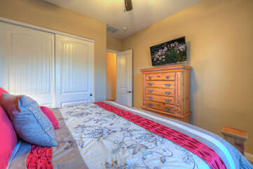 King bed in home's second bedroom is perfect place to enjoy a bestseller or marathon watching of a favorite show