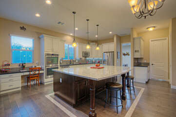Open and bright kitchen provides appealing gathering area for meals and more