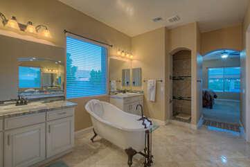 Ensuite primary bath has a clawfoot soaking tub, walk in shower and dual vanities