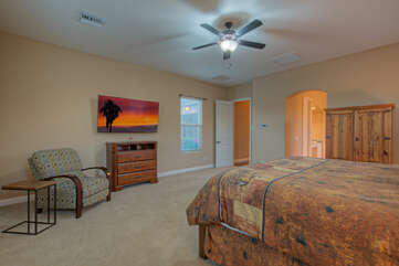 Primary suite offers secluded space for favorite TV programs and peaceful slumber